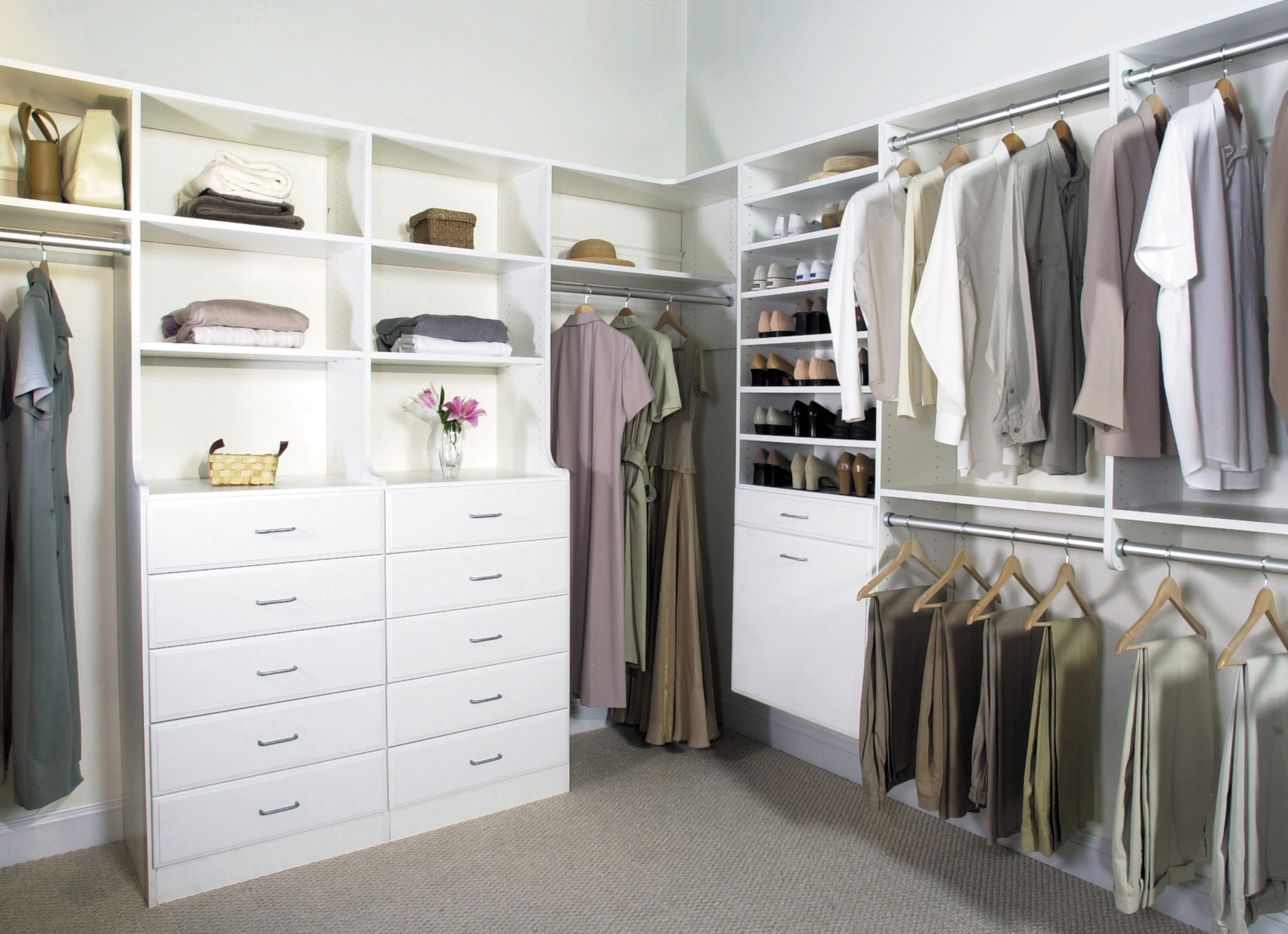 Walk In Closet With Double Clothes Hangers, Hutch And Shoe Shelves In A  White Finish.